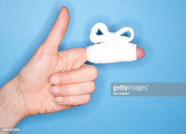 bandaged finger - cut on finger stock photos and pictures