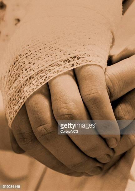 bandaged hand - elastic bandage stock photos and pictures