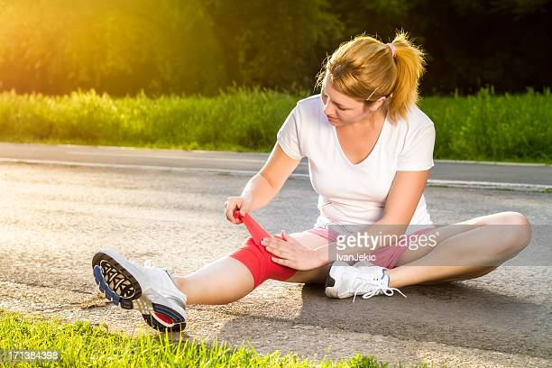 bandaging the knee - swollen stock photos and pictures