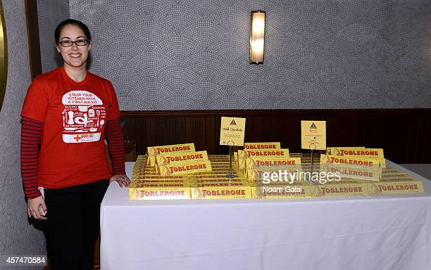 BandAid volunteer poses with Toblerone chocolate bars at Ample Hills Brooklyn's Best Dessert Party during the Food Network New York City Wine Food...