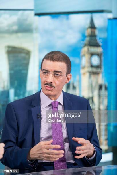 Bandar Bin Mohammed AlHajjar chairman of the Islamic Development Bank gestures while speaking during a Bloomberg Television interview in London UK on...