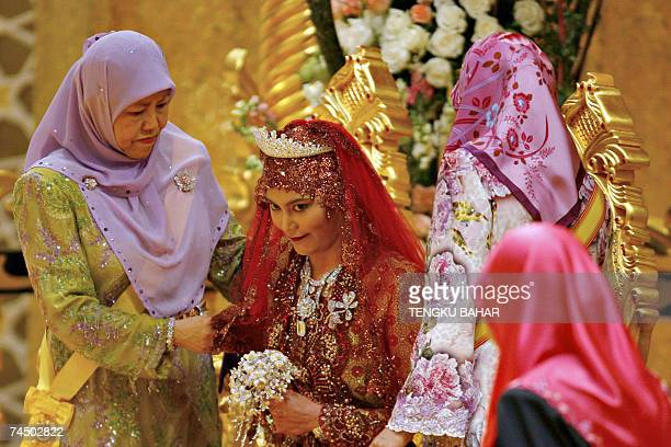 Princess Majeedah Nuurul Bulqiah smiles as she is seated on her ceremonial chair during a wedding ceremony with Pengiran Khairul Khalil at the Nurul...