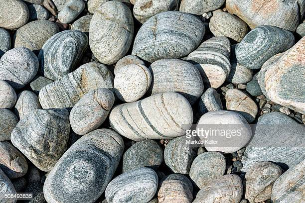Banded and round gneiss, on the gravel beach, Geopark Scourie Bay, Sutherland, Scotland, United Kingdom, Europe