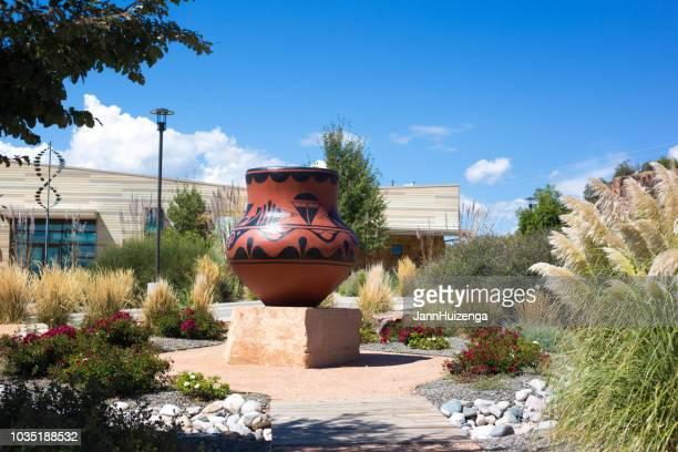bandelier national monument, nm: visitors' center - pueblo built structure stock photos and pictures