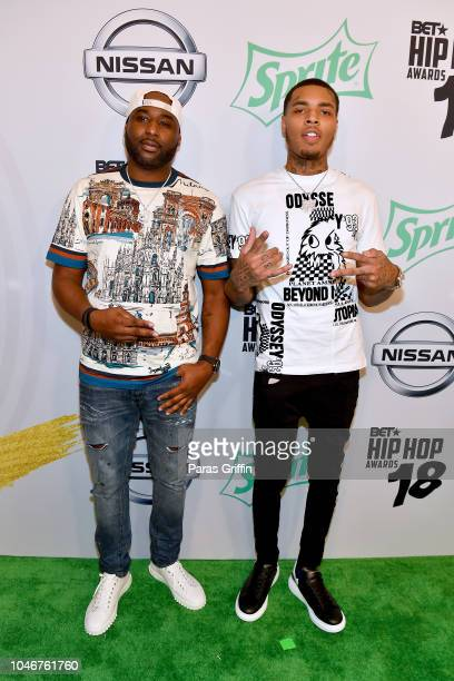 Bandhunta Izzy and guest arrive at the BET Hip Hop Awards 2018 at Fillmore Miami Beach on October 6 2018 in Miami Beach Florida