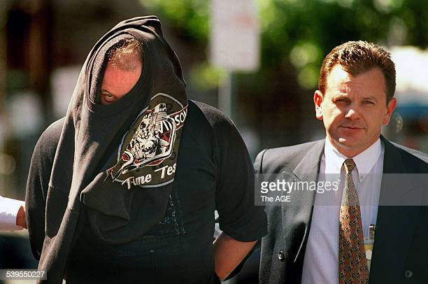 Bandidos motorbike gang member is walked into the Ballarat Courthouse by police after a raid on their premises 10 December 1997 THE AGE Picture by...
