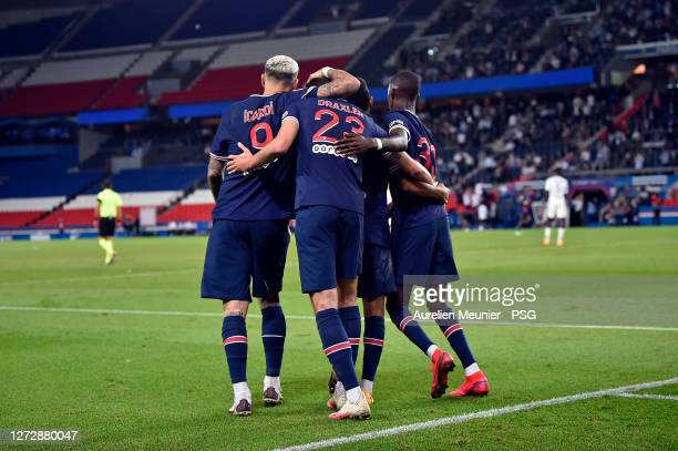 Bandiougou Fadiga and Mauro Icardi of Paris Saint-Germain congratulate teammate Julian Draxler after scoring during the Ligue 1 match between Paris...