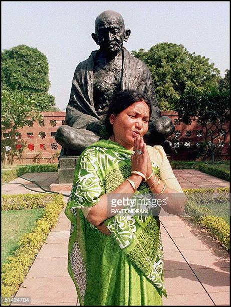 Bandit Queenturned member of parliament Phoolan Devi walks in front of the statue of Mahatma Gandhi on the ground of the parliament in New Delhi 24...