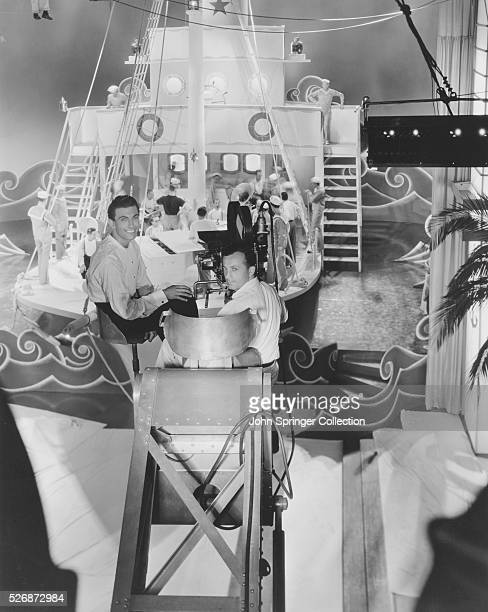 Bandleader Eddy Duchin takes a ride with the assistant cameraman on the set of the 1935 musical Coronado