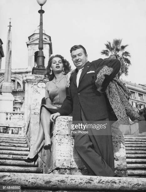 Bandleader Xavier Cugat and his wife actress Abbe Lane on the Spanish Steps in front of the Trinità dei Monti during a holiday in Rome Italy circa...