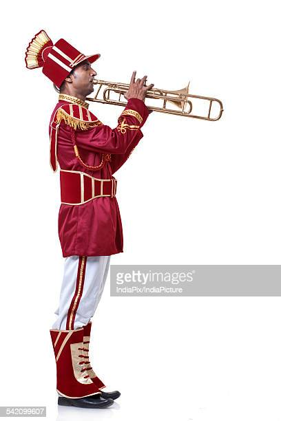 bandmaster playing on a trumpet - adults only stock pictures, royalty-free photos & images