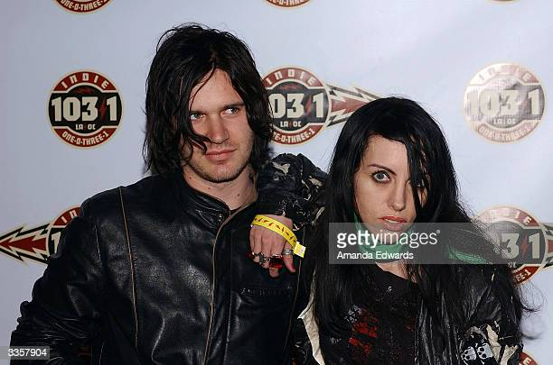 Bandmates Jeremy Brown and Roxy Saint arrive at the 1031 Celebrates 103 Days in Los Angeles party on April 13 2004 at Avalon in Hollywood California...