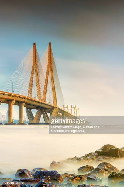 bandra worli sea link of mumbai during sunset - ムンバイ ストックフォトと画像