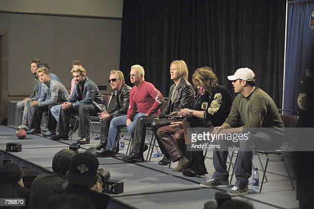 Bands N'sYNC and Aerosmith share the stage during a press conference for performers in the 2001 Super Bowl XXXV halftime show at the Tampa Convention...