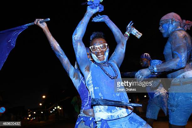 Bands of revellers parade and party wearing mud oil and paint during the early morning J'ouvert street procession as part of Trinidad and Tobago...