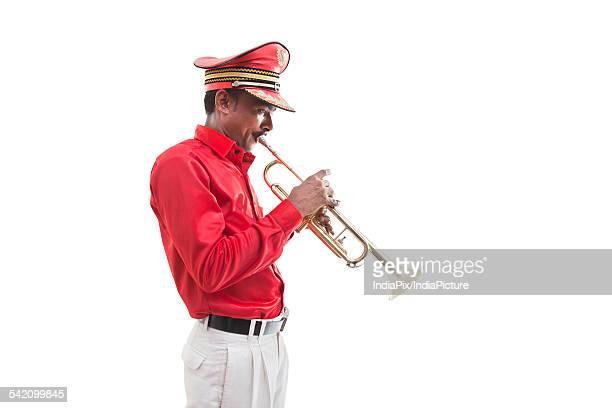 Bandwala playing on a trumpet