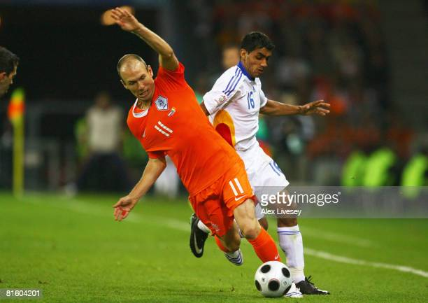Banel Nicolita of Romania and Arjen Robben of The Netherlands battle for the ball during the UEFA EURO 2008 Group C match between Netherlands and...