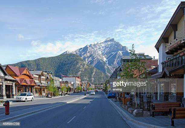 banff avenue and mt. norquay - banff stock photos and pictures