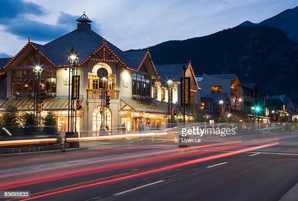 banff avenue at dusk - avenue stock pictures, royalty-free photos & images
