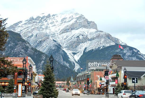 banff avenue retail area in  banff, alberta- winter - banff stock photos and pictures