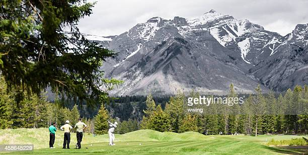 banff golf course and golfers - banff springs golf course stock photos and pictures
