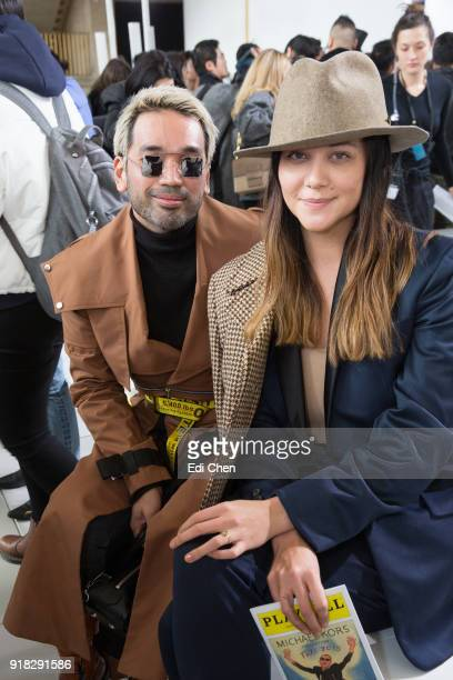 Bang Pineda and Sarah Meier attend the Michael Kors Collection Fall 2018 Runway Show at the Vivian Beaumont Theatre on February 14 2018 in New York...