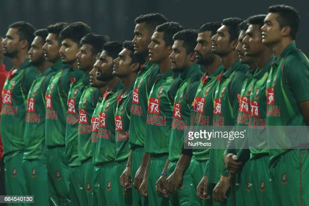 Bangaldesh cricket team members sing their national anthem before the start of 1st T20 International cricket match between Sri Lanka and Bangladesh...