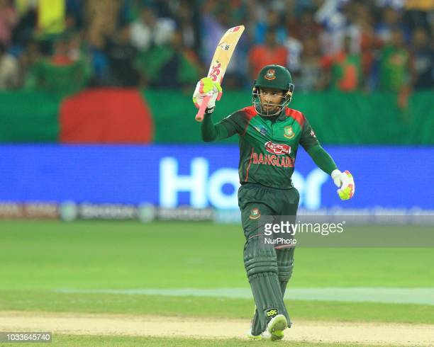 Bangaldesh cricketer Mushfiqur Rahim celebrates his 100 runs during the first cricket match of Asia Cup 2018 between Sri Lanka and Bangladesh in...