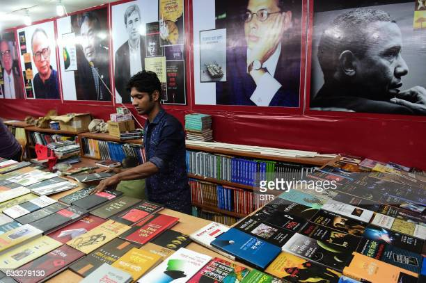 A Bangaldeshi salesman arranges books at a stall during the country's largest bookfair in Dhaka on February 1 2017 Bangladesh's largest book fair...