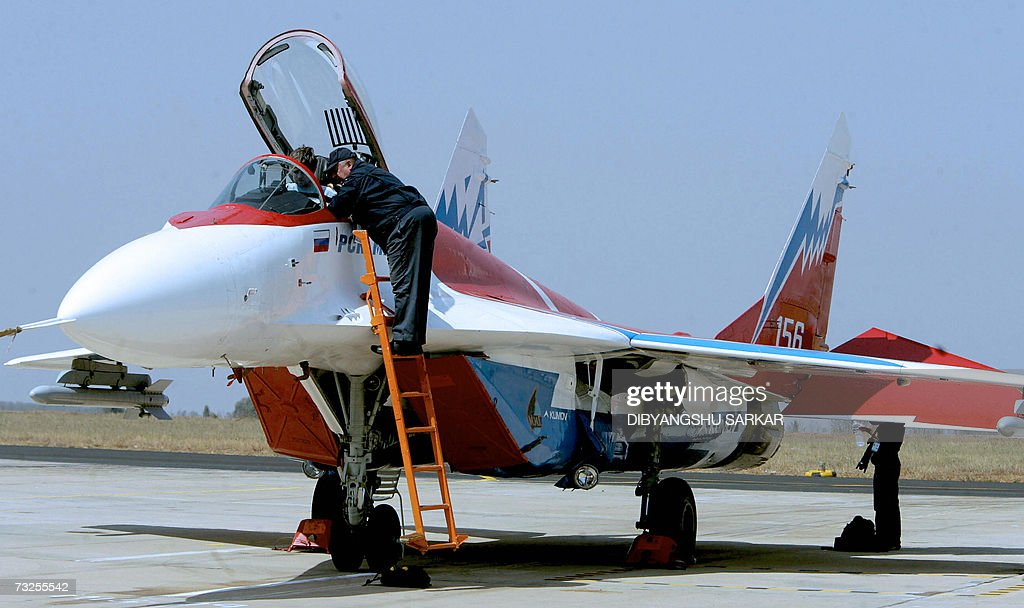 A Russian engineer works on a MiG-29 aircraft during the
