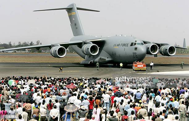 A US made Boeing Globemaster is watched by a crowd of spectators as it prepares for take off during the fourth day of Aero India 2007 at The...