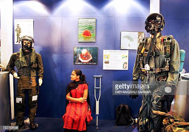 An Indian physically challenged girl with her crutches sits inside a stall of the Defence Research and Development Organisation during the third day...