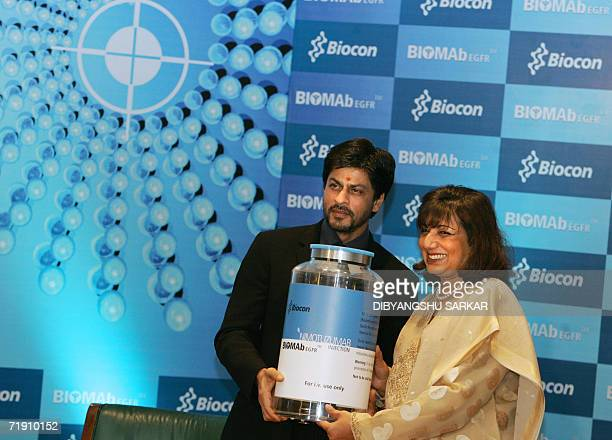 Bollywood actor Shah Rukh Khan along with the chairwoman of biotechnology company Biocon Limited Kiran Mazumdar Shaw unveils a giant size replica of...
