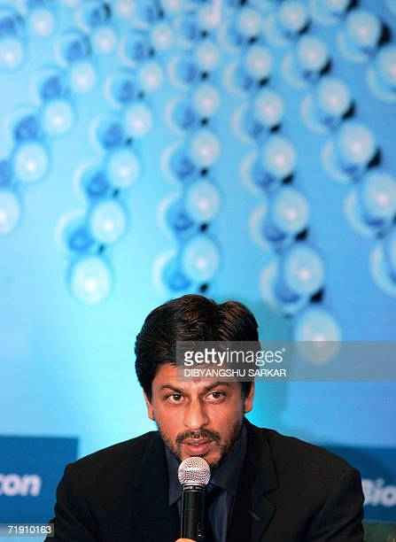 Bollywood actor Shah Rukh Khan answers a question after unveiling a giant size replica of a bottle of the Cancer Drug BIOMAbEGFR developed by the...