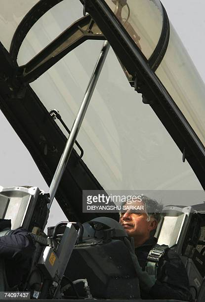 Chairman of India's Tata Group Ratan Tata sits inside a US made F16 aircraft after it landed during the second day of the Aero India 2007 at the Air...
