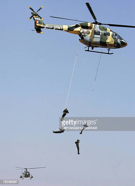 Indian Army's Commandos hang by a rope from a helicopter during a display on the first day of Aero India 2007 at the Yelahanka Air Force Station in...