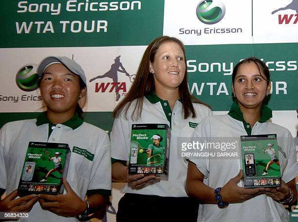 Indian tennis player Sania Mirza is joined by fellow players South Africa's Liezel Huber and US Vania King during a product launch in Bangalore, 13...