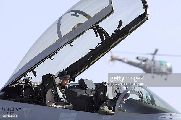 Indian tycoon and chairman of the Tata Group Ratan Tata sits in the copilot seat of a US made F18 aircraft ahead of a flight during the third day of...