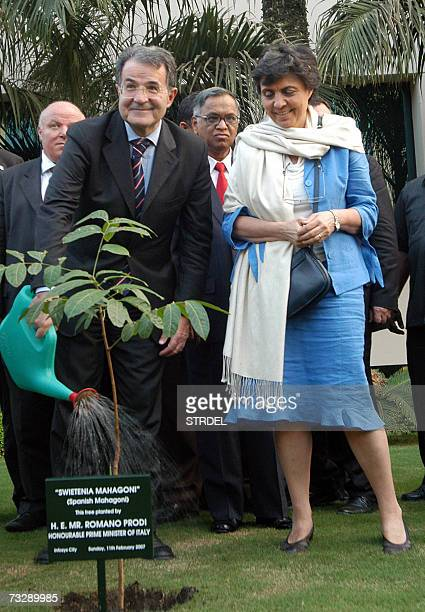 Italian Prime Minister Romano Prodi accompanied by his wife Flavia Franzoni pours water on a sapling which he planted as Infosys Chief Mentor N R...