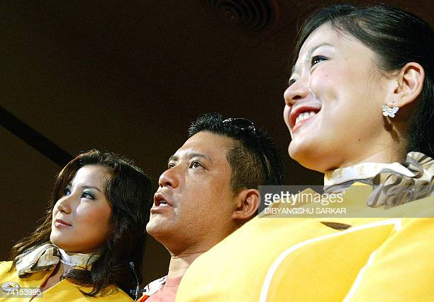 Nok Air Air hostesses pose for a photograph with company Chief Executive officer Patee Sarasin during the launch of Nok Air's international...