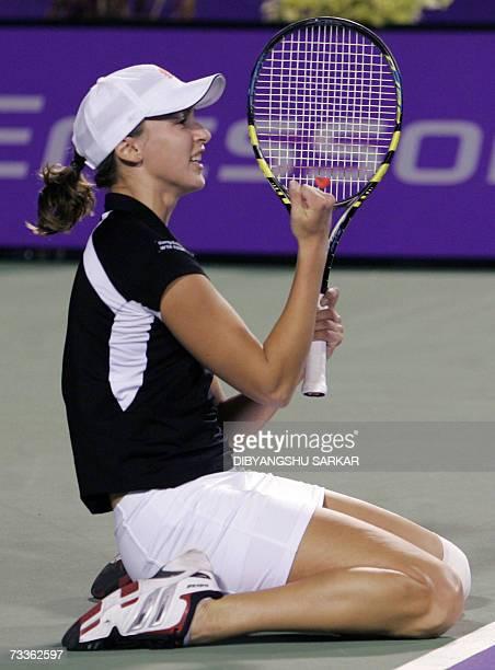Russian Yaroslava Shvedova celebrates her win over Italian Mara Santangelo during the final match of the WTA Bangalore Open in Bangalore 18 February...