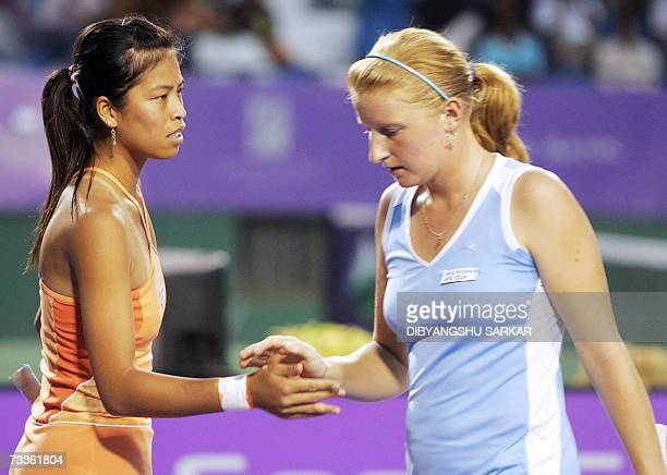 Taipei tennis player SuWei Hsieh celebrates with her partner Russian Alla Kudryavtseva after winning a point against their Taipei opponents YungJan...