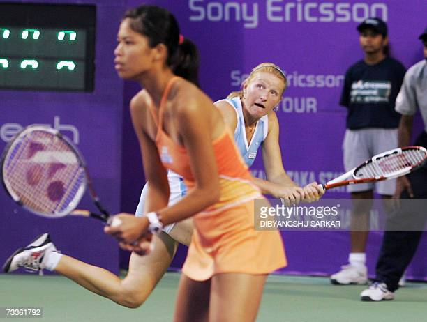 Taipei tennis player SuWei Hsieh looks on as her partner Russian Alla Kudryavtseva plays a shot against their Taipei opponents YungJan Chan and...