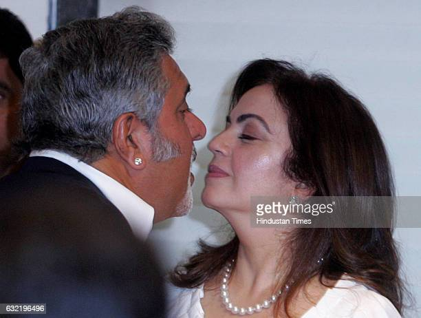 Bangalore Royal Challengers owner Vijay Mallya and Mumbai Indians owner Nita Ambani greet each other at BCCI working Commitee meeting in Mumbai on...