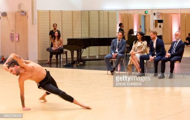 Bangarra's Chair Michael McDaniel Britain's Prince Harry his wife Meghan and Baangarra's Executive Director Philippe Magid watch the rehearsal of...