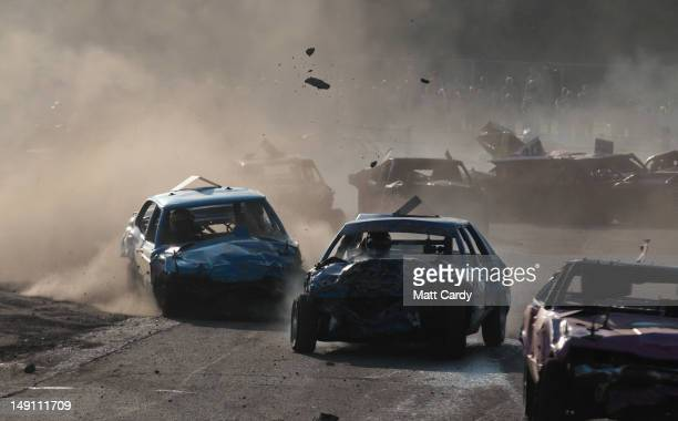 Banger racers crash during a heat in the all Cortina banger race meeting to mark the car's 50th anniversary at Swaffham Raceway on July 22 2012 in...