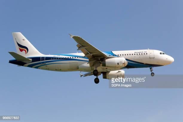 Bangkok Airways boutique airline Airbus 320 landing at Phuket airport