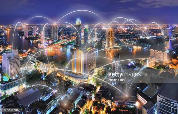 Bangkok Chao Phraya river at night with business connection concept at Bangkok, Thailand.