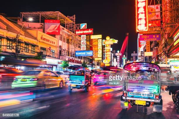 bangkok chinatown traffic at night - auto rickshaw stock pictures, royalty-free photos & images