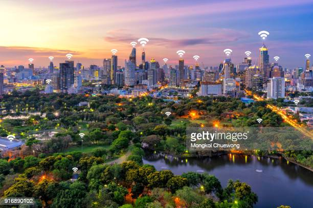 bangkok cityscape and lumpini park at bangkok thailand. network connection concept , wifi at business district - phone icon stock pictures, royalty-free photos & images